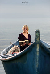 Reading in the boat (dim.pagiantzas | photography) Tags: reading read books model female woman people face ambi spot light boat boating sea sky clouds seascape water waterscape horizon canon textures colors blue