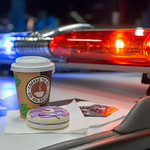 Coffee to go and donuts on a police car thumbnail