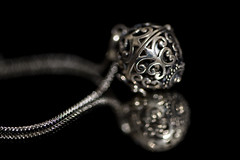 Harmony Ball (Amy Maher) Tags: bokeh 105mm nikond750 focus reflection blackout black silver chain necklace ball harmonyball macromonday lowkey dof