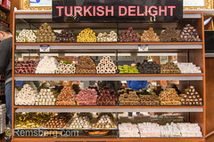 A glass case in front of shop holds an assortment of tempting Turkish delights for sale at Istanbul Spice bazaar in Turkey (Remsberg Photos) Tags: bazaar market souk spice istanbul turkey egyptianbazaar commerce business retail shopping exchange commodities vendor turkishdelight candy sweet lokum rahatlokum confections indulgence food freshness temptation bountiful abundant forsale marketplace indoor choice products middleeast confection treat consumerism economy