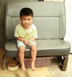 boy on a car seat