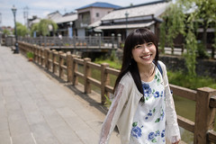 Happy young woman traveling traditional Japanese town (Apricot Cafe) Tags: img38817 asia asianandindianethnicities japan japaneseethnicity japaneseculture katoricity sawarakatori sigma35mmf14dghsmart beautifulwoman blackhair bridge buildingexterior candid carefree charming cheerful chibaprefecture colorimage copyspace cultures day enjoyment happiness leisureactivity lifestyles longhair lookingatcamera nature oneperson onlyjapanese onlywomen onlyyoungwomen onoriverchibaprefecture outdoors people photography river sky smiling sustainablelifestyle toothysmile tourism tourist traveldestinations waistup walking willowtree women youngadult katorishi chibaken jp