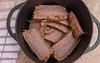 Slices pressure cooked beef brisket in cast iron casserole. (annick vanderschelden) Tags: beef meat brisket beefbrisket sliced slices cut food cooking pressurecooking refrigerated reheat culinary casserole iron black belgium
