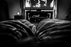 Movie Night (Randall ]|[ Photography) Tags: watching us home pants nc randall indoors interesting picture photographer photography position movie view sitting relax northcarolina resting winstonsalem tv indoor men different usa dark relaxing unitedstates nice photo angleofview blackandwhite rest pic