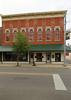 Building — Ottawa, Ohio (Pythaglio) Tags: ottawa ohio putnamcounty building structure historic commercial threestory brick altered storefronts 44windows segmentalarched hoodmolds italianate cornice brackets put3157