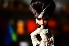 Queen Bee (jessandgrace) Tags: doll portrait colorimage colors bokeh backgroundblur dress crochet handmade dollclothes figure face eyes grayeyed hair beehive brunette cerise everafterhigh eah pretty beauty glamour cute indoor