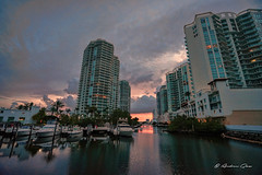 Sunset in Sunny Isles. (Aglez the city guy ☺) Tags: sunnyislesbeach architecture afternoon yacht colors building channel pier waterways water saltwater sky clouds walkingaround walking urbanexploration miamifl