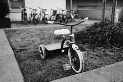 Beginning (borishots) Tags: 35mm 35mmf2 carlzeiss carlzeisssonnar carlzeisssonnar35mmf2 cybershot fullframe sonycybershotdscrx1 sonyrx1 zeiss zeisssonnar zeisssonnar35mmf2 sony beginning bike bikehandlebars bikes oldbike smallbicycle childbicycle ride childhood playground bicycles bw blackandwhite monochromatic monochrome oslo norway scandinavia memories grain f2 wideopen wideangle pedals contrast clarity