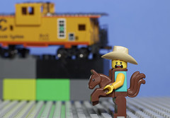 Things just haven't been the same since they built the railroads (N.the.Kudzu) Tags: tabletop lightroom miniature cowboy hoscale caboose primelens canondslr canon50mmf18 macro flash lego