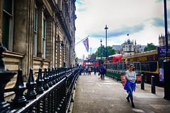 Westminster Station in London, United Kingdom (` Toshio ') Tags: toshio london unitedkingdom england greatbritain sidewalk westminsterstation bus tourists girl woman people flag britishflag europe european fujixt2 xt2 underground westminsterabbey