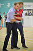 Prince Harry and Prince William, Duke of Cambridge play 5 a side football during a visit to the Coach Core project at Gorbals Leisure Centre on July 29, 2014 in Glasgow, Scotland. (Photo by Jamie Simpson