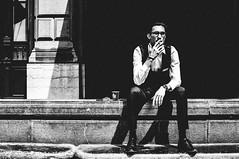 sharp dressed man (matthias hämmerly) Tags: candid street streetphotography shadow contrast black white bw monochrom monochrome city town urban blackandwhite strasse people monochromphotography einfarbig personen silhouette zuerich zurich switzerland sun smoker man smoking waiting warm suit well dressed