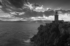 The lighthouse (tzevang.com) Tags: greece lighthouse sunset beautiful seascape clouds sun loutraki bw
