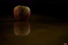 The Forbidden Fruit (MBates Foto) Tags: 85mm affirmation apple availablelight closeup color devotional existinglight fruit indoors inspirational nikon nikond810 nikonfx reflection tabletop texture zeisslens spokane washington unitedstates 99203