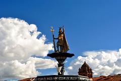 Cuzco (makingacross) Tags: cuzco cusco peru inca empire qusqu plaza de armas clouds statue