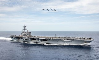 Aircraft fly over the USS George H.W. Bush during Chesapeake 2018.