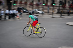The intersection sprint (jeremyhughes) Tags: cycling rider d700 nikon panning movement motion speed bicycle green yellow red city urban cyclist street london shorts sneakers nike bike riding sprint urbansprint rack fenders messengerbag action