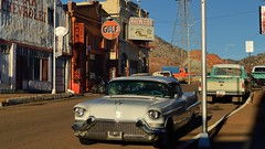 Way back when - Erie Street, Lowell district, Bisbee, Arizona. (edk7) Tags: nikond3200 edk7 2013 us usa arizona cochisecounty bisbee lowell district eriestreet mainstreet old vintage classic lateafternoon automotive automobile car vehicle architecture building oldstructure city urban street pavement 1957cadillaccoupedeville pickup truck sign signage hill