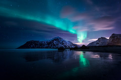 Mesmerizing (kolja_wi) Tags: norway aurora northerlights borealis lofoten landscape wallpaper beach color sony a6000 nature blue red dark moody sea rocks mountain explore winter ice peak sunset islands samyang norge snow travel long exposure