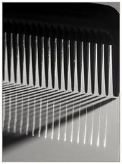 Comb (EddieAC) Tags: macromondays readyfortheday comb shadow reflection backlit blackandwhite bw