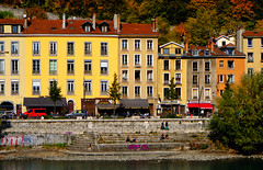 Colorful Grenoble, France (` Toshio ') Tags: toshio grenoble france isèreriver river buildings architecture french mountain autumn leaves fall bank riverbank europe european europeanunion grafitti fujixt2 xt2 car street city restaurant steps people riverside colorful