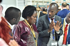 Speaker Rebecca Kadaga listening to Fahad Kateregga of Aziz Property Investments at the 8th AIM Conference