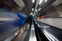 Listening to music as the world rushes by - Waterloo (Luke Agbaimoni (last rounds)) Tags: london londonunderground londontube train trains escalator