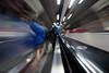 Listening to music as the world rushes by - Waterloo (Luke Agbaimoni (last rounds)) Tags: london londonunderground londontube train trains escalator