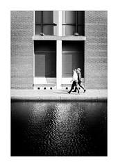 Canal Commute (Dave Fieldhouse Photography) Tags: streetphotography street canal towpath birmingham citycentre urban architecture building people walker walkway water symmetry contrast sunshine fujifilm fujixpro2 fuji fujinon35mmf2 wwwdavefieldhousephotographycom monochrome mono blackandwhite