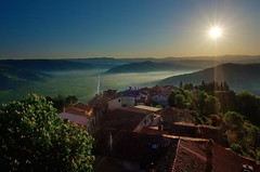 Morning mist (Jumpin'Jack) Tags: early morning mist fog covering valley river mirna little medieval town motovun istria croatia old venetian fortress fortified stone wall houses buildings roofs trees hill street sun rays sunstar hdr