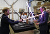 Prince Harry (L) and Prince William, Duke of Cambridge try out light sabres during a tour of the Star Wars sets at Pinewood studios on April 19, 2016 in Iver Heath, England. (Photo by Adrian Dennis