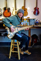 Zero Chan in the shop picking up his very cool Fernandez Bass (David Neely) Tags: bass guitars