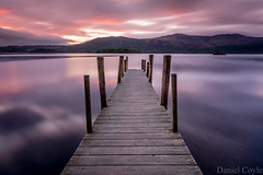 Dreamy Sunrise (Daniel Coyle) Tags: derwentwater keswick lake lakedistrict jetty pier sunrise longexposure dawn cumbria nationaltrust natural nature danielcoyle nikon nikond7100 d7100 england uk clouds dreamysunrise lowbrandelhow brandelhowbay water reflections cloudy hills mountains fells sky countryside view symmetry