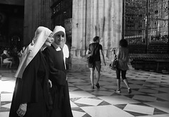 On a mission (Marian Pollock) Tags: seville spain nuns cathedral architecture people pair blackandwhite women church portrait habbit