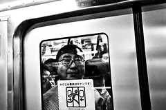 Happy Commuter... (Victor Borst) Tags: smile street streetphotography streetlife reallife real realpeople asia asian asians faces face candid travel travelling trip traffic traveling train urban urbanroots urbanjungle blackandwhite bw mono monotone monochrome city canon fuji fujifilm xpro2 expression metro subway sub underground yamanote cityscape citylife tokyo japan japanese