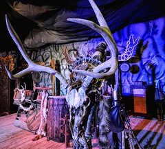 The Cave Stage (clarkcg photography) Tags: renaissance stage thecave dark mood lights candles blue red deer deerskull antlers band props tribal