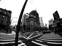 Broadway in Manhattan NYC (MassiveKontent) Tags: streetphotography bwphotography streetshot gopro fisheye architecture geometric lines symmetry building bw contrast city monochrome urban blackandwhite streetphoto manhattan nyc crosswalk road asphalt street broadway newyorkstreet newyorkcitystreet newyork midtown metropolis metropolitan america cityscape