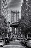 Manhattan Bridge (soboy5) Tags: cobblestone street bridge nyc brooklyn city framing mono monochrome bw blackwhite dumbo washingtonstreet brownstones buildings sky clouds newyorkcity candid cars streetscene streetphotography trees people
