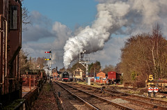 Winter sun and steam (Peter Leigh50) Tags: great gcr central railway railroad rail steam sun sunshine sunny sunlight sky cloud clouds signal semaphore box cabin wagon people station quorn 9f 92214 br standard std train trees track trains