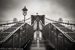 Rainy Day on the Brooklyn Bridge (ericjmalave) Tags: newyork new york city brooklyn manhattan monochrome mono black white long exposure architecture landmark bridge