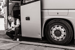 The Coach Driver (raymorgan4) Tags: coach driver bus passenger wheels tyres ipad coffee cigarette break rest steps cardiff wales street candid blackandwhite fujifilm fujifilmx100f fujifilmglobal x100f hgv vehicle reading tablet fuel emergency door button smoking