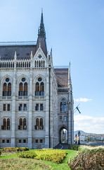 Hungarian Parliament, Budapest - another view (Marian Pollock) Tags: budapest europe hungary architecture spire windows arch mountains vegetation lights tower danube clouds flag
