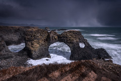 Stormbringer (Mika Laitinen) Tags: arnarstapi canon5dmarkiv europe gatklettur iceland leefilters arch cliff cloud landscape longexposure mountain nature ocean outdoors rock sea shore sky storm water wave westernregion is