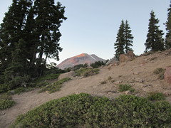 Hiking at dusk with Lassen Peak in the distance (Prairie Star) Tags: lassenvolcanicnationalpark nationalparkservice california westernstates volcano volcanic volcanicpeak lassenpeak 10457ft nationalpark trees dusk outside outdoor nature hiking
