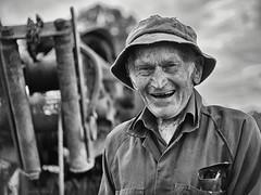 Ralph the inventor (gnarlydog) Tags: australia oldman portrait character happy bokeh shallowdepthoffield subjectisolation contextualbokeh machine industrial hat smile gzuiko40mmf14 adaptedlens vintagelens wrinkles monochrome blackandwhite bw