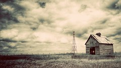 rural ruins.... (HWW) (BillsExplorations) Tags: windmill windmillwednesday waterpump field grass fence barn crib abandoned decay ruraldecay forgotten rural ruins sky clouds old vintage sepia oldfashioned