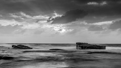 Black and White Rocky Sunrise Seascape (Merrillie) Tags: daybreak landscape morning blackandwhite nature dawn terrigal waves waterscape water theskillion newsouthwales clouds earlymorning nsw sunrise sky ocean monochrome sea rocky coastal rocks outdoors seascape coast centralcoast cloudy australia