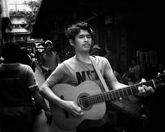 The walking guitarist 😊 (-Faisal Aljunied - !!) Tags: eyecontact ricohgr2 guitarist indonesia jakarta streetphotography faisalaljunied