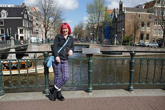 Dudette on a Bridge (steve_whitmarsh) Tags: amsterdam netherlands city urban building architecture street bridge water canal niqui portrait fence