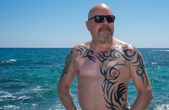 Protaras, Cyprus. (CWhatPhotos) Tags: cwhatphotos cyprus protaras eastern pose shades sunglasses sun look tattoo tattooed bw portrait man male sunny day waters 2018 april digital camera pictures picture image images photo photos foto fotos that have which contain olympus seafront golden coast beach blue sky skies holiday water sea deep color colour 43 micro four thirds penf